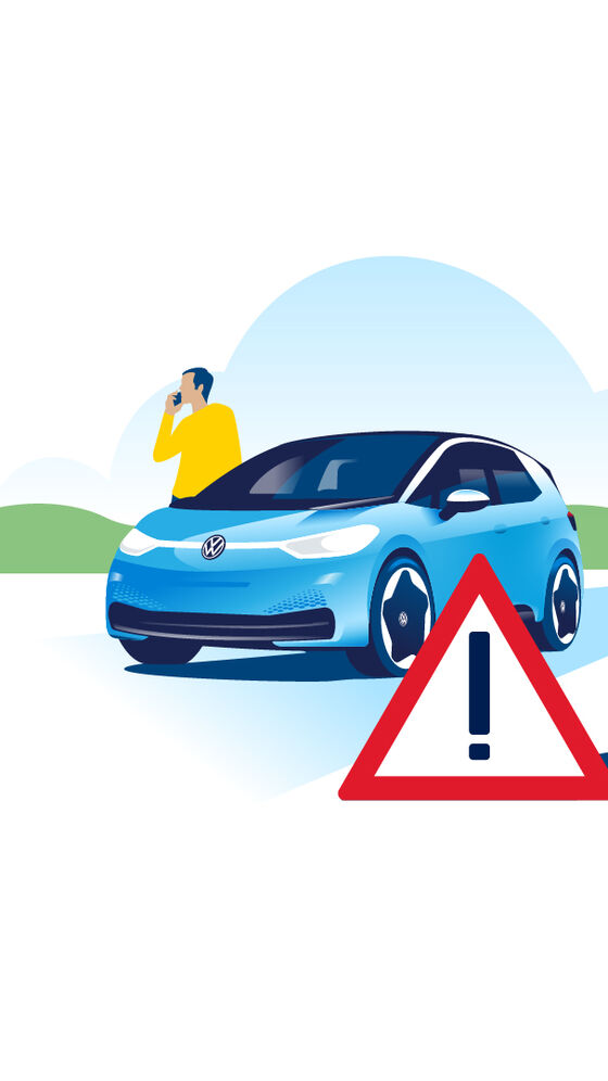 There is a warning triangle in front of a Volkswagen ID.3 with a man on the phone behind him.